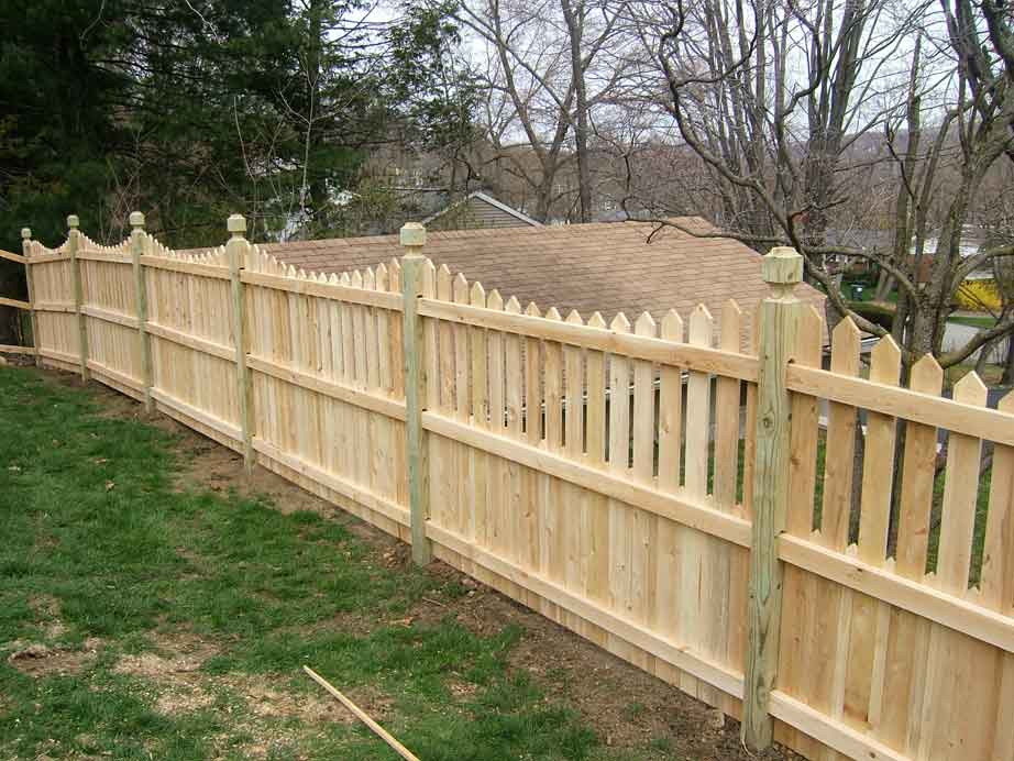 Cedar Picket with Single Point, Scalloped, and a Skirt, on Mortised Pressure Treated 4 x 4 Posts with Hunterdon Tops