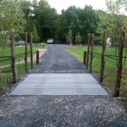 Deer Fence with Cattle Guard Across Driveway
